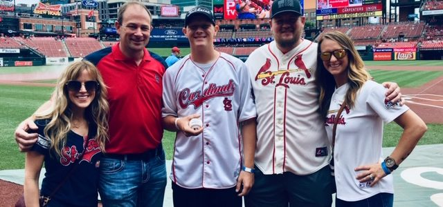 Throws out first pitch at Busch